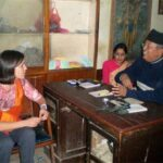 Gina visiting a renowned Ayurvedic doctor in Nepal